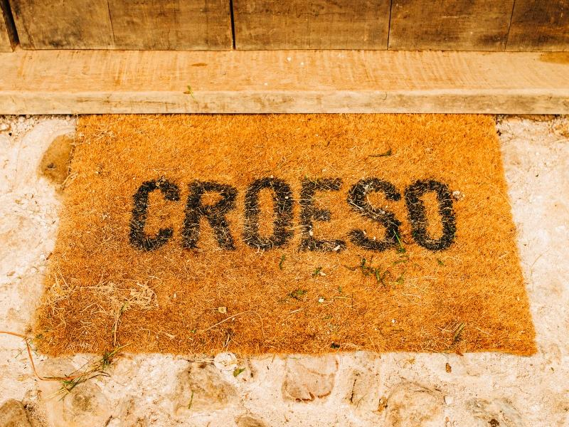 Photo of a doormat with Welsh word for 'welcome', Croeso, on top